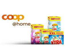Divers produits X-TRA à côté d'un logo de coop@home